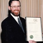 Mark receiving his Management Consultants Certificate from C.M.C.